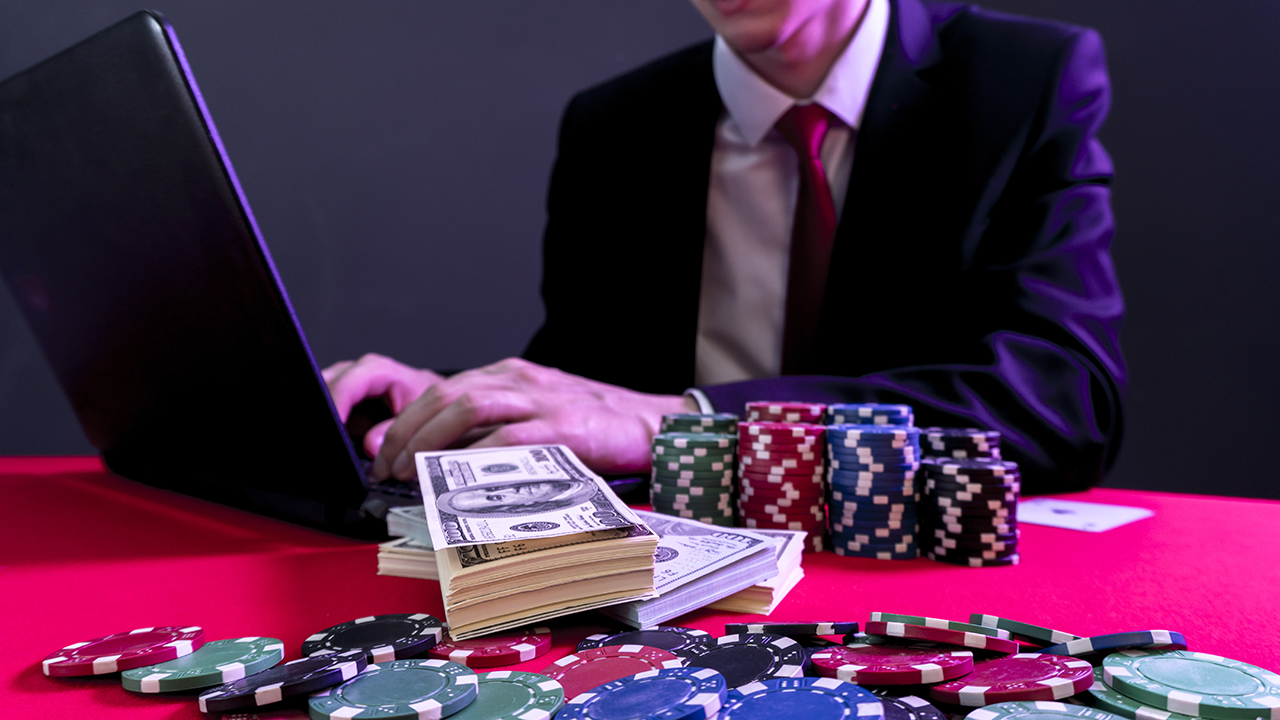 man is sitting at the poker table. poker game. online casino